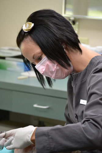 Amy preparing a dental patient for a tooth filling.